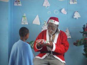 Tata Lumka playing Santa!