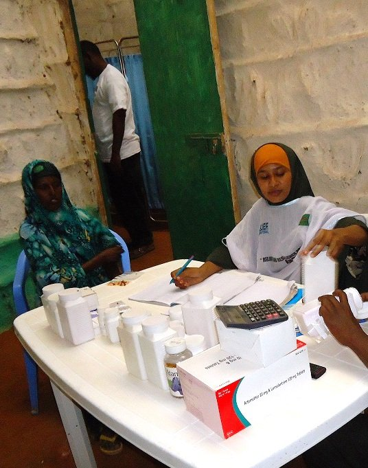 One of our female nurses dispensing medicine