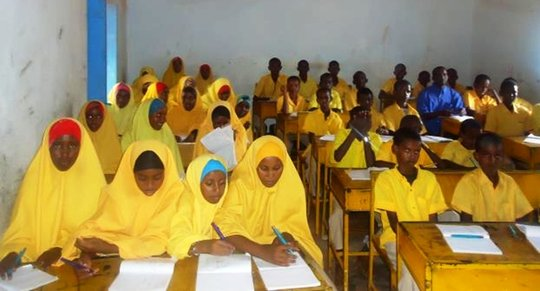 Students in class at one of the schools RI assists
