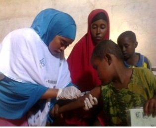 A child receiving vaccinations at a RI clinic