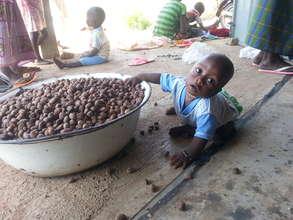 Gushie kiddo Woompanie in the sheanuts.