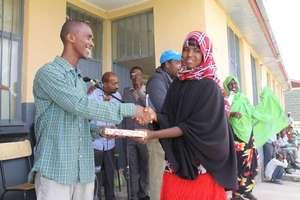 Somali refugee receives English-Somali dictionary