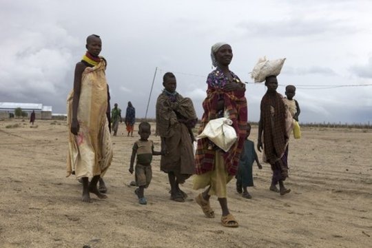 Family leaving the stabilization center with food.