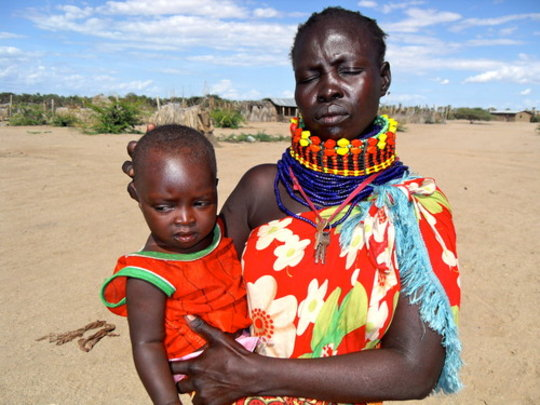 Napeyok Esirete with his mother in Kerio, Turkana.