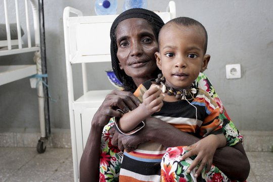 Hawi holds her now healthy nephew Ahmed Habib