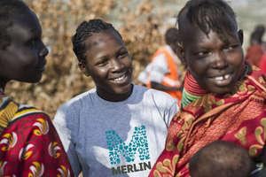 A Merlin health worker with Turkana women