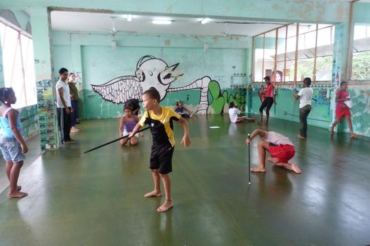Dancing using sticks!