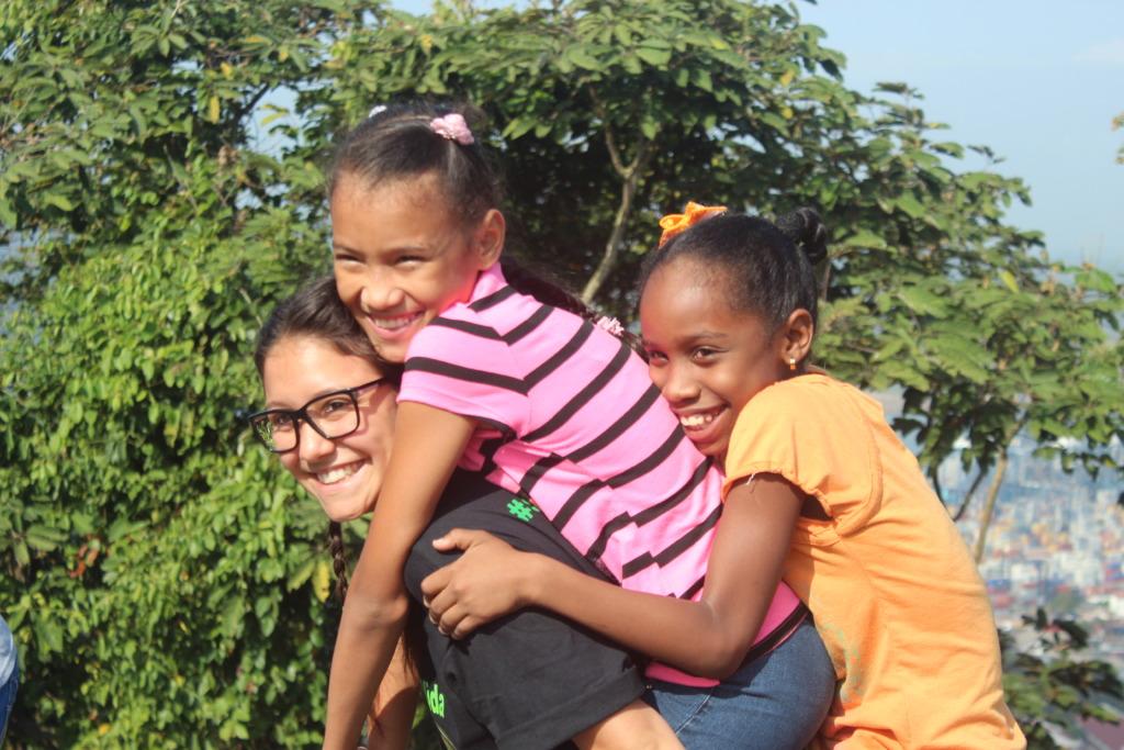 Volunteers having fun with the kids