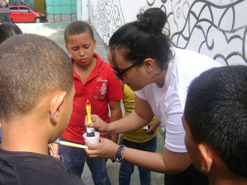 Painting a mural in Santa Familia Building