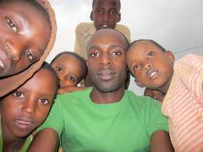A volunteer with kids after a teaching session