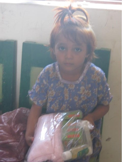 A girl happy to receive health kit