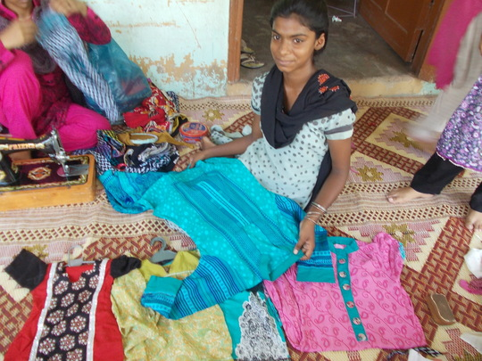 Girls earning income by sewing for their education