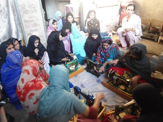 Girls busy in the sewing center