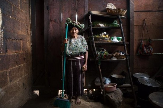 An elderly women taking care of the house