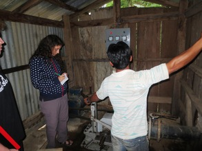 Diana, EWB-UK volunteer engineer, assessing MHP