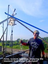 Arno, local operator, enjoying the water supply