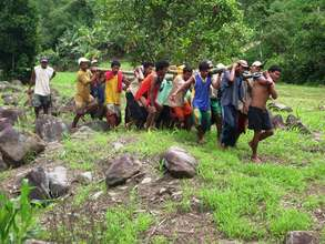 Villagers Hauling Turbine for Microhydro Project
