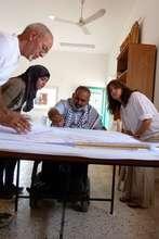 Working with Haj Sami to develop town plan