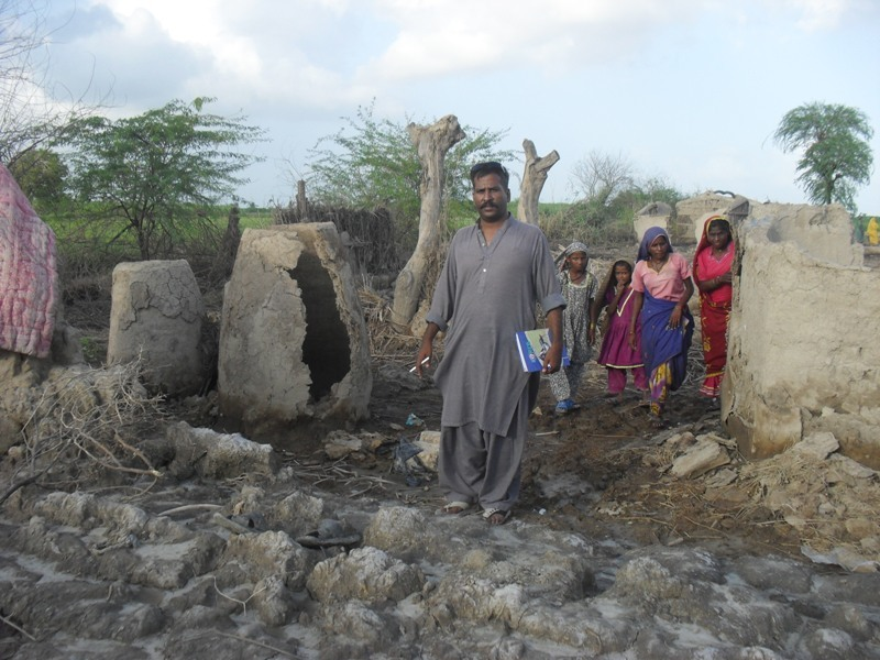 AHD manager visiting houses damaged by floods 2011