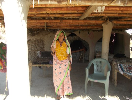 Women Repaired her house with Bamboes roof