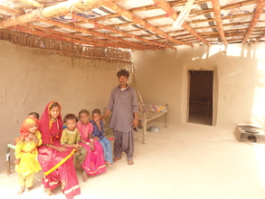 Women and children happy in new house