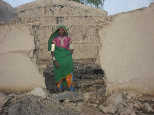 Women showing her house broken during rain floods