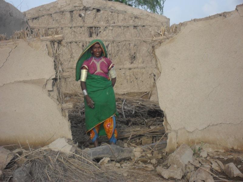 Women showing her house broken during rain floods