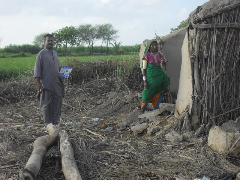 Program manager visiting houses damaged by floods