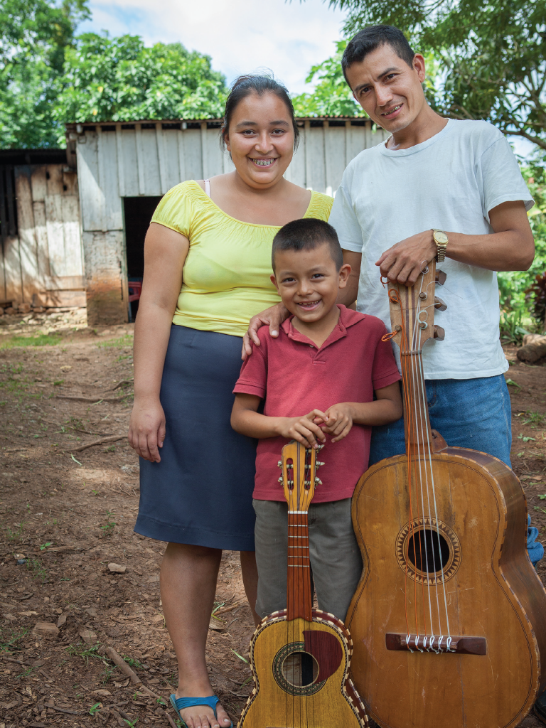 Walter, Yamile, & Walter Jr. with their guitars