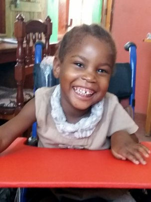 Halima in her new wheel chair