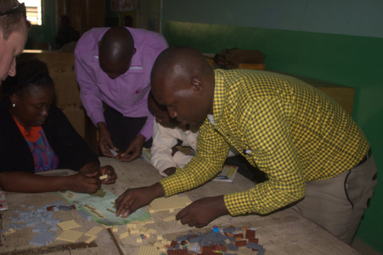 Teachers learning to follow a Lego plan