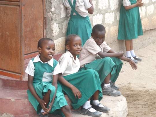 Three little girls hoping for a new classroom