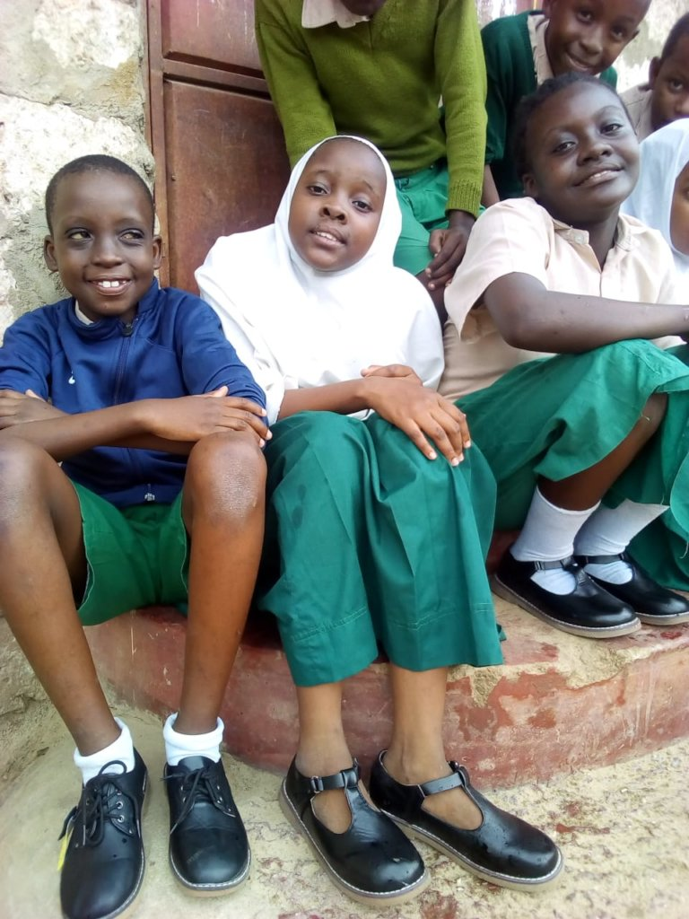 Happy children with new shoes