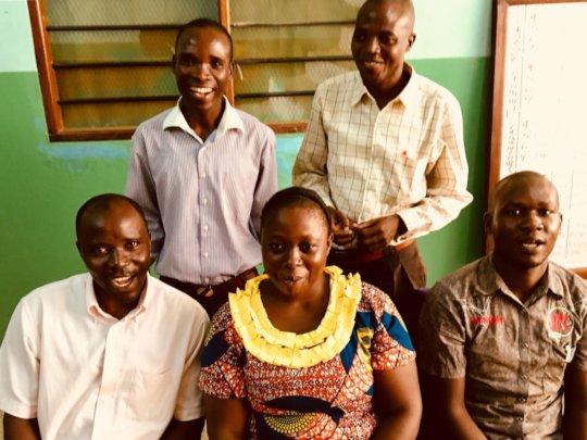 Happy teachers in new school building