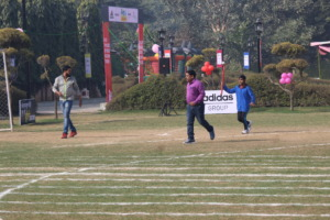 Bhushan Running with the Torch On Sports Day