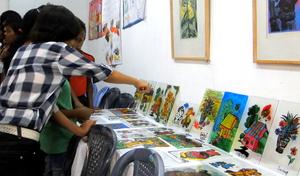 Chlidren and their Art work at the Summer Camp