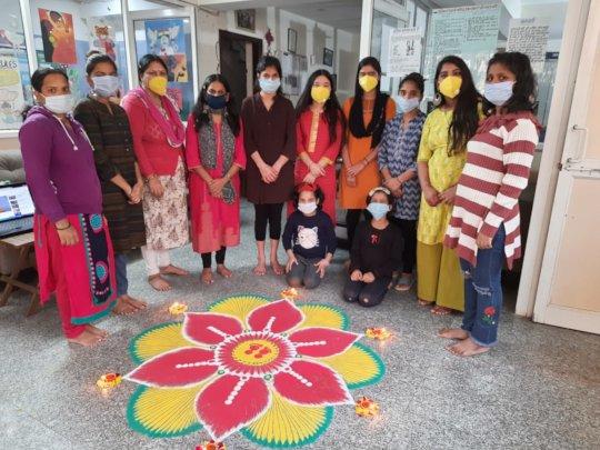 Girls showing their Rangoli