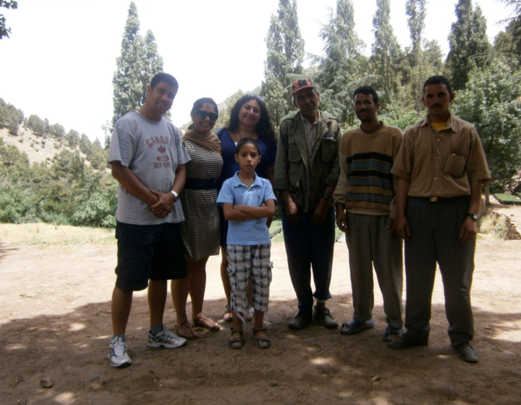 Us with Abderrahim, Omar, and government officials