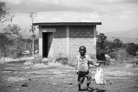 Boy at communal latrine