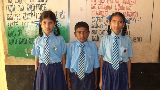 Domlur school kids proudly displaying star badges