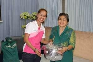 Grandmother receiving her price: a new pan