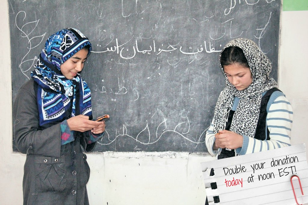 Girls learning to use the mobile phones