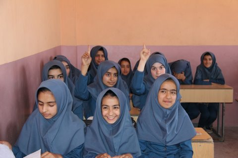 This photo depicts a group of girls in a classroom setting at one of the Afghan Institute of Learning