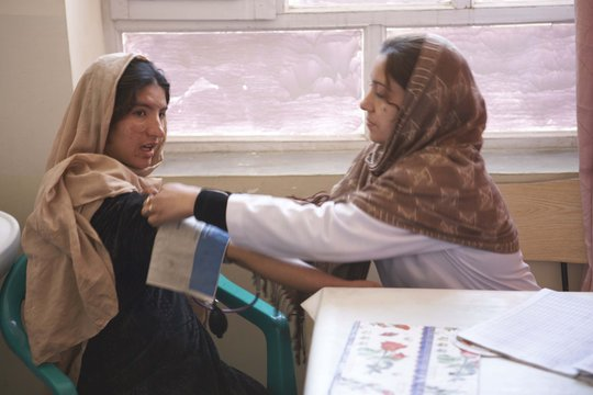 Doctor treating adolescent girl