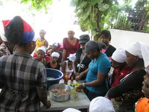 KOFAVIV mentor teaching cooking class to girls