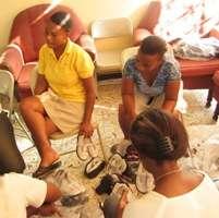 KOFAVIV organizers preparing packets of shoes