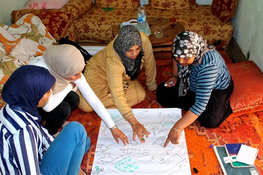 Amina and Akrich Women Collaborating