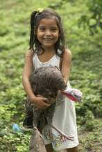 Young girl and a turkey