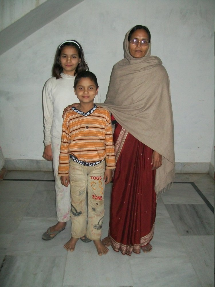 Mithlesh, her mother, and her younger brother