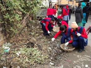 School girls cleaning to spread the word